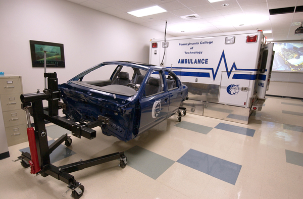 Paramedic students practice their skills in the Klump Academic Center, in a laboratory outfitted with a fully functioning ambulance.