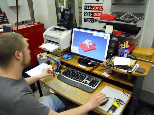 John L. LaFever Jr. uses computer-aided machining software called GibbsCAM to program an automated milling machine to manufacture a steering knuckle.