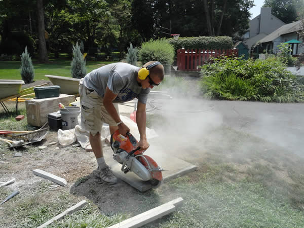 Intern using a chop saw