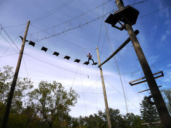 Year Two student participating in a ropes course