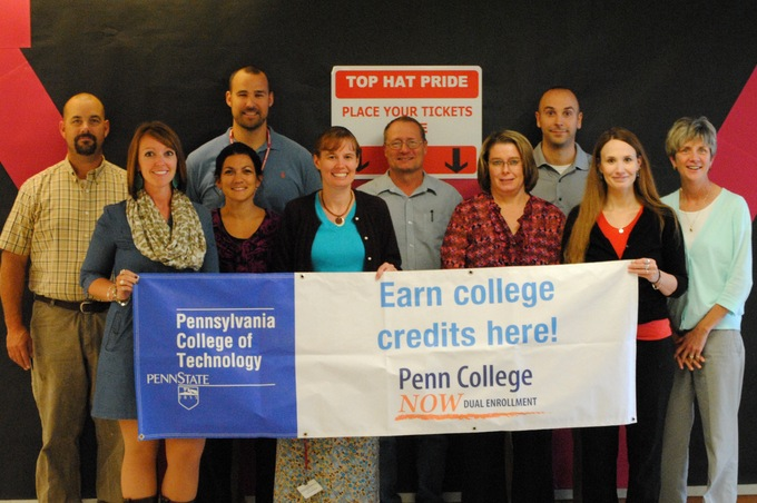 Williamsport professionals proudly display the Penn College NOW banner to give Williamsport School District student the opportunity to earn college credits in high school. Front row (left to right) – Elizabeth Segraves, Patricia Miller, Rebecca Hutchinson, Mary McCormick, Spring Moore. Back row (left to right) – Randy Williamson, Andrew Paulhamus, Dave Gephart, Kevin Yokitis, Phyllis Sieber.