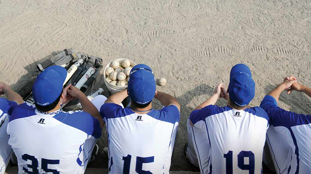 Wildcat baseball players watch the action. File photo.