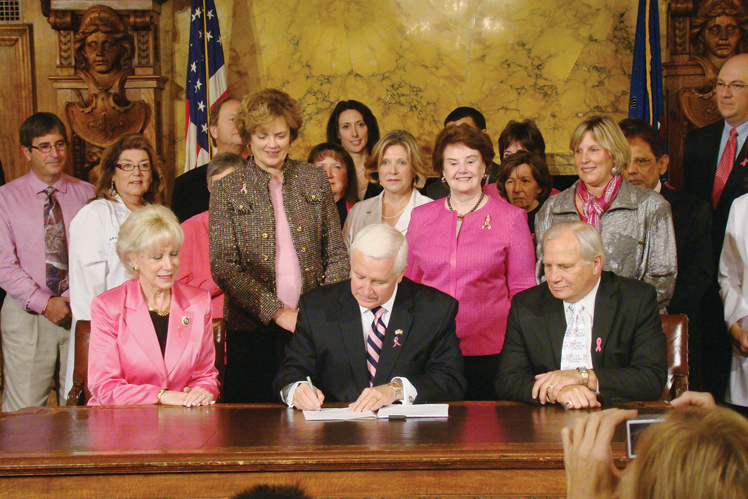 Spinello joins supporters as former Gov. Tom Corbett, center, signs the Pennsylvania Breast Density Notification Act that was introduced by Sen. Bob Mensch, seated right. Photo courtesy of the Pennsylvania Breast Cancer Coalition.