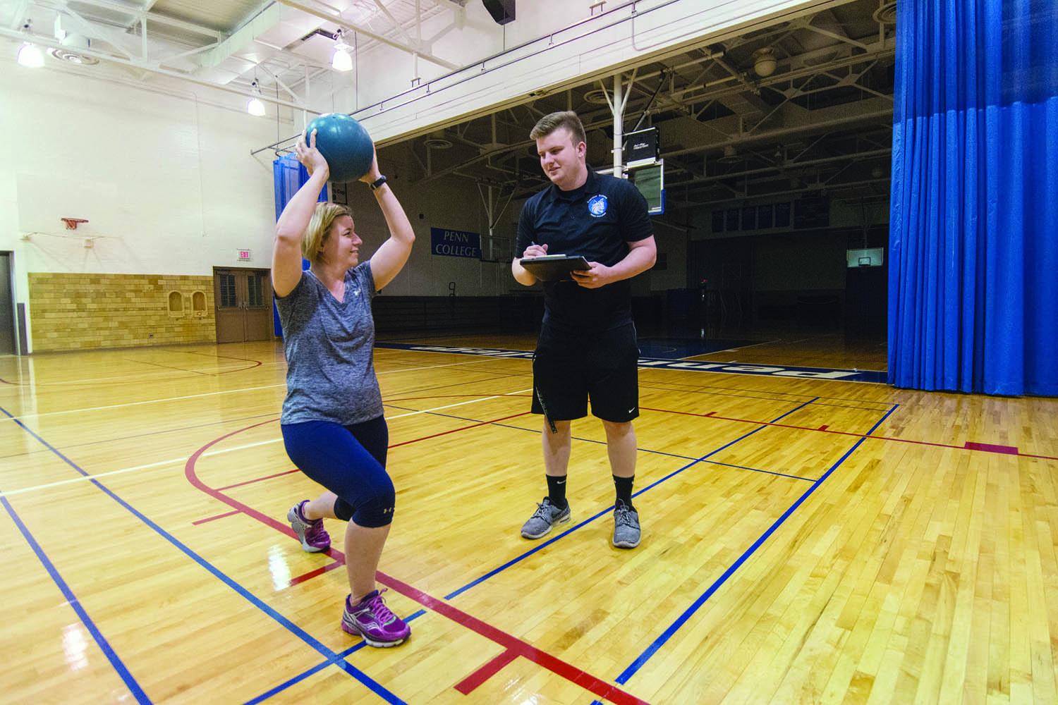 Medicine balls are among the functional tools that Brandon S. Peters uses in his sessions with Carolyn R. Strickland.