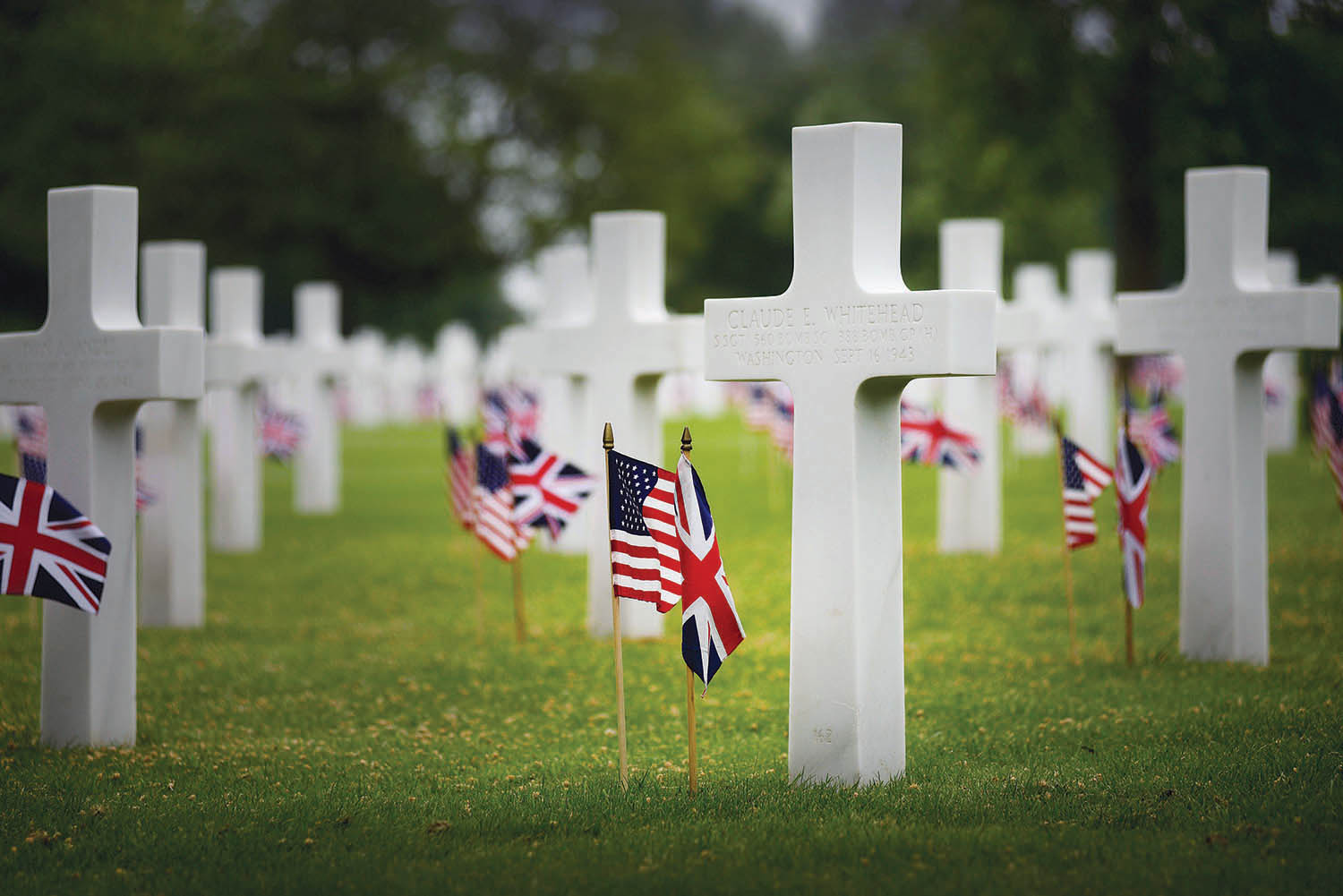 Headstones at Madingley American Cemetery, in Cambridge, England, mark the graves of U.S. Army, Army Air Corps, Navy, Marine Corps and Coast Guard members, but mostly airmen. Eck laid a wreath at the cemetery during a Memorial Day ceremony in 2011. Photo courtesy of U.S. Air Force