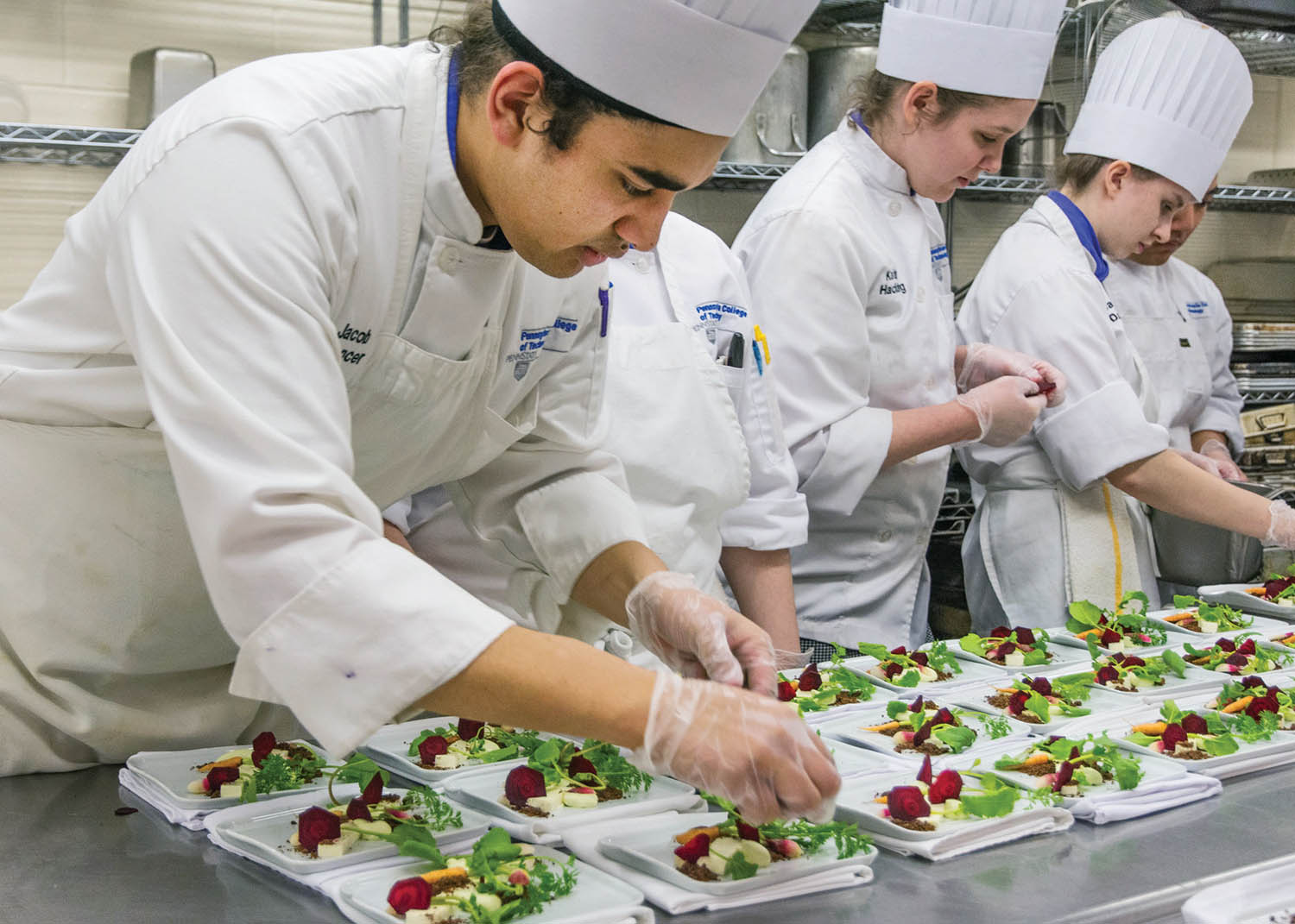 "Jacob O. Spencer assembles a tiny garden of vegetables, panna cotta, crème fraiche and edible ""soil"" under the direction of 2016's Chef David Danielson, of Churchill Downs.  Photo by Jennifer A. Cline."