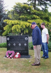 Raymond O. Eck, '41, salutes a memorial for the 93rd Bombardment Group at Hardwick Aerodrome near Norwich, England, where he was stationed during World War II. Photo courtesy of June Eck