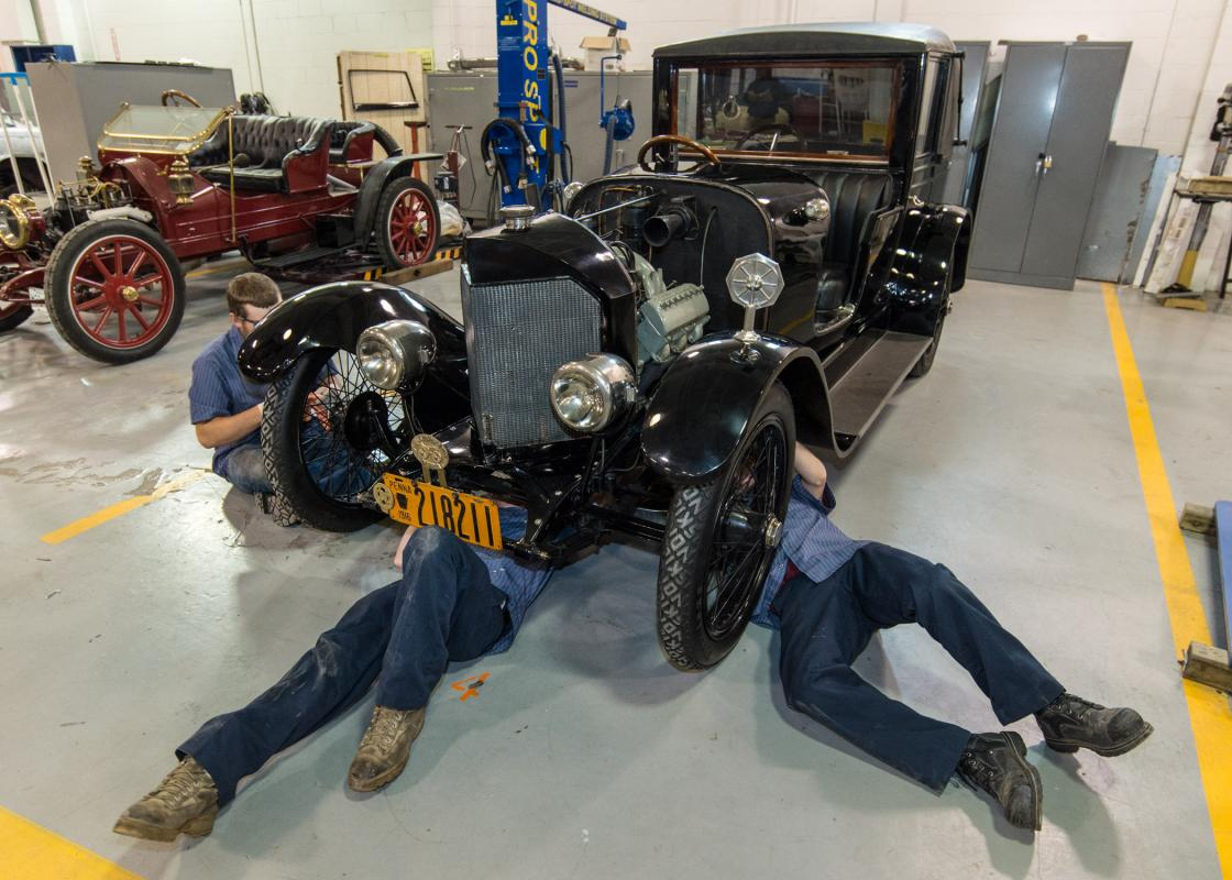 Students working on car