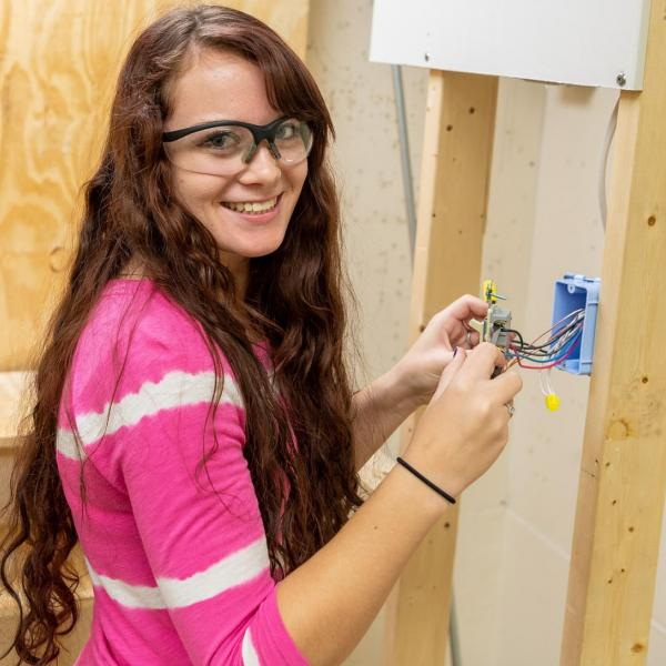 Female Electrical Construction Student